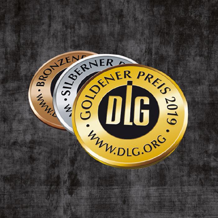Drei DLG-Prämierungsmedaillien in Bronze, Silber und Gold